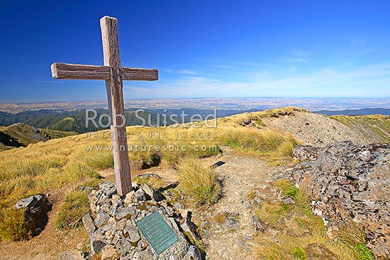 Memorial cross to mountaineers killed in WWII on the summit of Mount (Mt) Hector (1529m) on the Southern Crossing of the Main Range of the Tararuas, Tararua Forest Park, Kapiti Coast District, Wellington Region, New Zealand (NZ) stock photo.