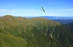 Glider over mountain range, Tararuas