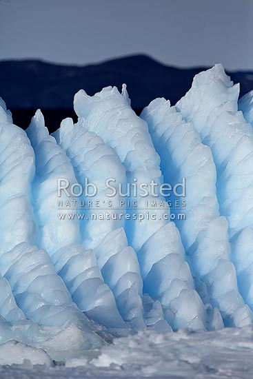 Water eroded patterns and ridges on a small rolled iceberg or bergy bit, Ross Sea, Antarctica stock photo.