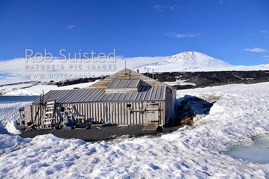 Captain Robert Falcon Scott's 1910-12 Terra Nova Expedition Hut at Cape Evans, Ross Island. Mount Erebus behind, Cape Evans, Ross Island, McMurdo Sound, Antarctica Region, Antarctica stock photo.