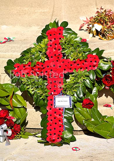 Flower wreaths and red poppies from ANZAC day commemorations, Havelock North, Hastings District, Hawke's Bay Region, New Zealand (NZ) stock photo.