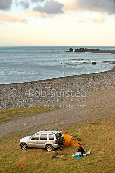 4x4 / 4wd tent camping at the coast. Jeep Cherokee, Wairarapa, South Wairarapa District, Wellington Region, New Zealand (NZ) stock photo.