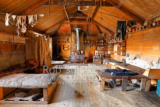 Interior of Ernest Shackleton's British Antarctic (Nimrod 1907-09) Expedition hut. Beds, stores and Smith and Wellstood Columbian Stove centre, Cape Royds, Ross Island, Antarctica stock photo.
