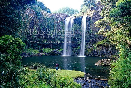 Family, mother with children, enjoying Whangarei Falls, a 25 metre waterfall on the Hatea River, scenic reserve, Whangarei, Far North District, Northland Region, New Zealand (NZ) stock photo.