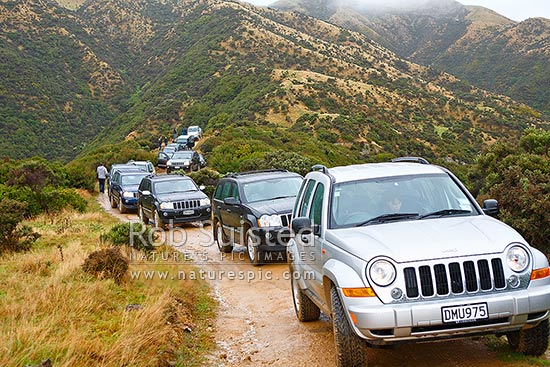 Jeep 4x4 four wheel drive Cherokee vehicles on 4wd trip, New Zealand (NZ) stock photo.
