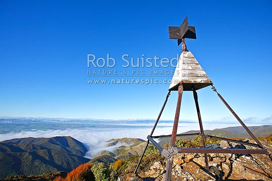 Looking east over the Wairarapa plains from the Remutaka (Rimutaka) Summit Trig walk (725m) above the Remutaka (Rimutaka) Road summit, Remutaka, Upper Hutt City District, Wellington Region, New Zealand (NZ) stock photo.