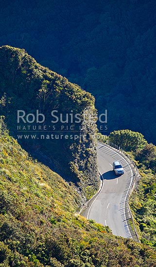 Car on the Remutaka (Rimutaka) Hill Road climbing to the 555m summit linkng Wellington and the Wairarapa (State Highway 2), Remutaka, Upper Hutt City District, Wellington Region, New Zealand (NZ) stock photo.