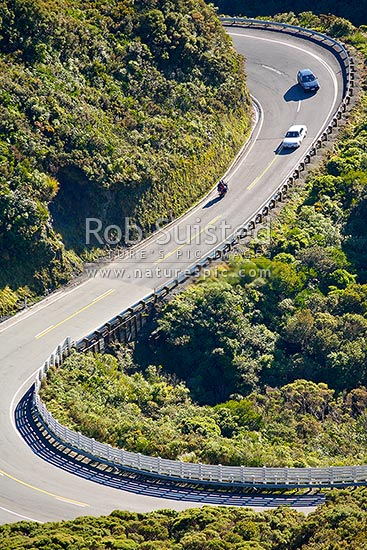 Cars and motorcycles on the Remutaka (Rimutaka) Hill Road climbing to the 555m summit linkng Wellington and the Wairarapa (State Highway 2), Remutaka, Upper Hutt City District, Wellington Region, New Zealand (NZ) stock photo.