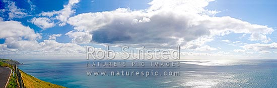 White clouds and blue sky over a shimmering sea, panorama viewed from the summit of the Paekakariki Hill Road, Paekakariki, Kapiti Coast District, Wellington Region, New Zealand (NZ) stock photo.