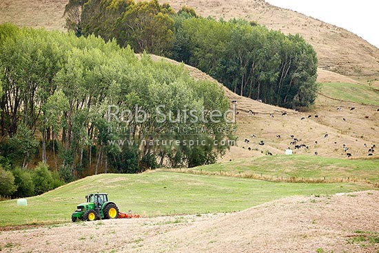 John Deere farm tractor 7530 premium ploughing or tilling padock field, New Zealand (NZ) stock photo.
