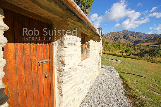Restored stone Needhams Cottage in historic gold boom town of Macetown (ca. 1862-1914). Department of Conservation (DOC) Historic Reserve and asset, Arrowtown, Queenstown Lakes District, Otago Region, New Zealand (NZ) stock photo.