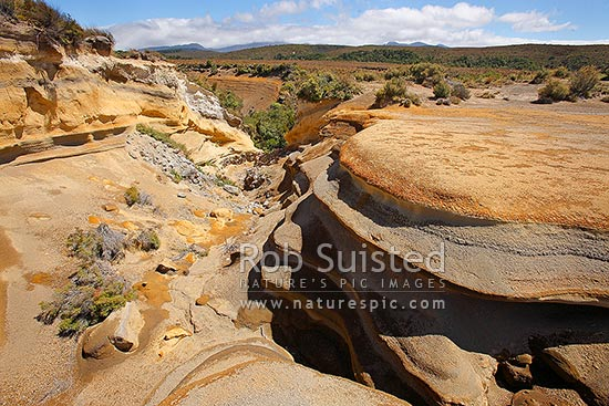 Rangipo Desert landscape showing water erosion of many eruption tephra layers in the volcanic plateau unter Mount Ruapehu, Mt Ruapehu, Ruapehu District, Manawatu-Wanganui Region, New Zealand (NZ) stock photo.