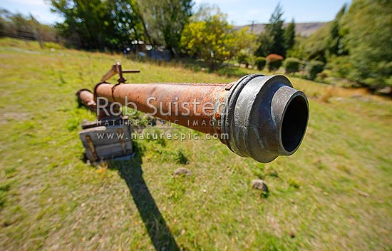 Historic Hydraulic Sluicing gun or cannon, used to wash or sluice gold from alluvial material by directing a water jet, Alexandra, Central Otago District, Otago Region, New Zealand (NZ) stock photo.