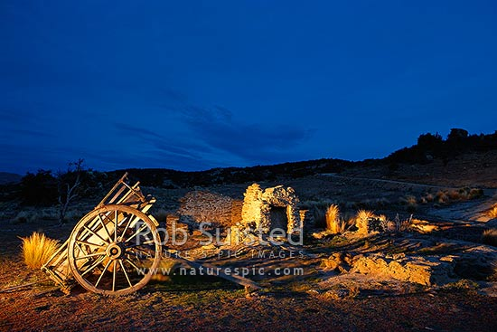 Historic Miner's stone cottage ruins and horse carriage at Logantown, Bendigo Historic Reserve. Photo at night, Bendigo, Central Otago District, Otago Region, New Zealand (NZ) stock photo.