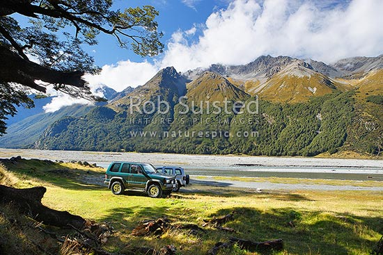 Hopkins Valley with 4 wheel drive vehicles outside Memorial Hut. Neumann Range across river, Lake Ohau, Twizel, Waitaki District, Canterbury Region, New Zealand (NZ) stock photo.