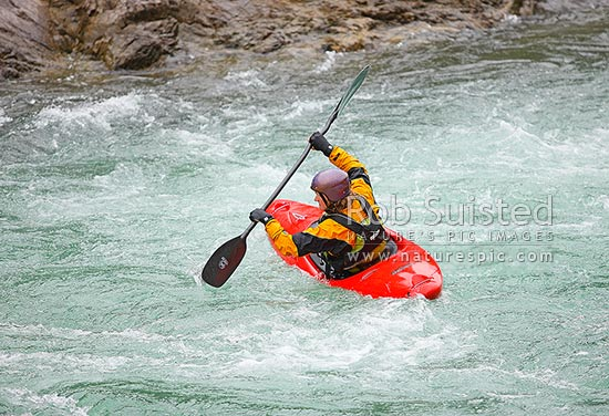 Whitewater kayaker paddling on the Buller River, Murchison, Tasman District, Tasman Region, New Zealand (NZ) stock photo.
