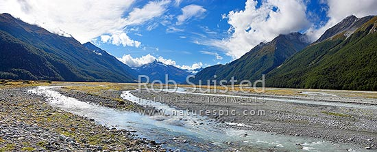 Hopkins Valley panorama. Braided river below Mount Ward (2645m) centre left, Mt Williams (2538m) centre. Neumann Range right, Lake Ohau, Twizel, Waitaki District, Canterbury Region, New Zealand (NZ) stock photo.