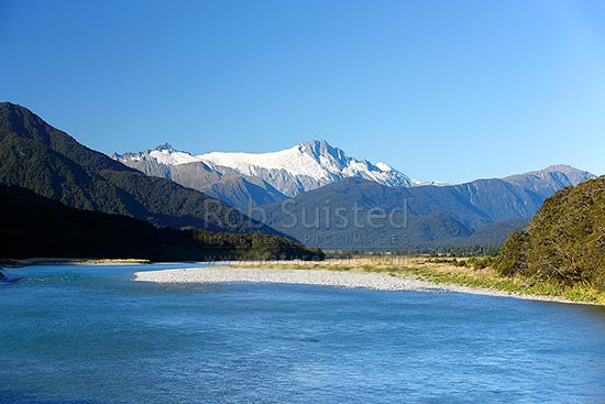 Mount Hooker (2652m centre) and Mt Cullaugh (2286m left) above the Haast River, Haast, Westland District, West Coast Region, New Zealand (NZ) stock photo.