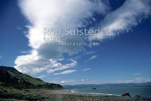 Cloud pattern of North westerly wind, southern Wairarapa, Ocean beach, Wairarapa, South Wairarapa District, Wellington Region, New Zealand (NZ) stock photo.