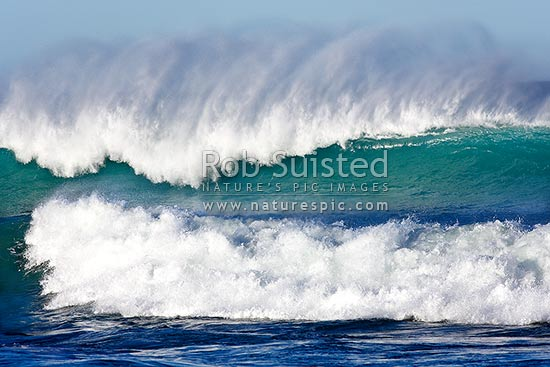 Surf, waves and sea running into the Wairarapa coast. Waves breaking with wind blown crests, Mataikona, Masterton District, Wellington Region, New Zealand (NZ) stock photo.
