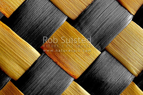 Traditional indigenous Maori weaving of flax leaves and fibre (Phormium sp. Harakeke). Criss cross pattern. Monotoned black and white and colour, New Zealand (NZ) stock photo.