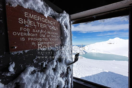 Dome Shelter entrance near summit of Mount Ruapehu, and Crater Lake. Sign; Emergency Shelter Only, emergency hut and volcanic monitoring equipment shelter, Tongariro National Park, Ruapehu District, Manawatu-Wanganui Region, New Zealand (NZ) stock photo.