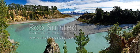 Waimakariri River Gorge on the Canterbury Plains. Torlesse Range and Southern Alps in snow in background. Panorama, Springfield, Selwyn District, Canterbury Region, New Zealand (NZ) stock photo.
