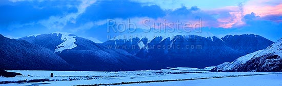 Waimakariri River valley in heavy winter snow twilight. Looking towards the Hawdon and Andrews Rivers, Arthur's Pass National Park. Panorama, Arthur's Pass National Park, Selwyn District, Canterbury Region, New Zealand (NZ) stock photo.