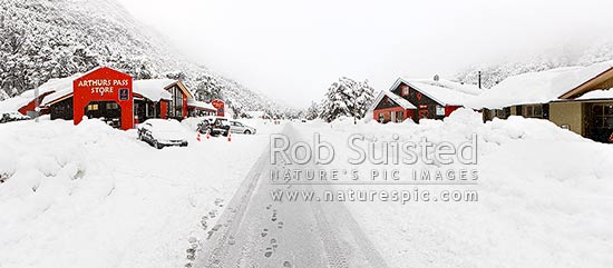 Arthur's Pass township in heavy winter snow. State Highway 73 to West Coast. Panorama, Arthur's Pass National Park, Selwyn District, Canterbury Region, New Zealand (NZ) stock photo.