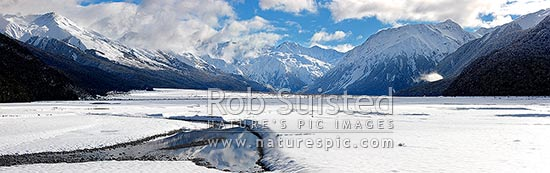 Waimakariri River valley headwaters in heavy winter snow. Panorama, Arthur's Pass National Park, Selwyn District, Canterbury Region, New Zealand (NZ) stock photo.