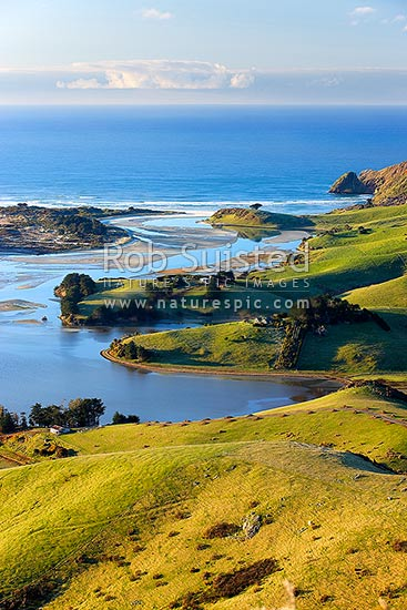 Otago Peninsula farmland and beaches around Hoopers Inlet. Allans Beach left, Sandy Mount right, Otago Peninsula, Dunedin City District, Otago Region, New Zealand (NZ) stock photo.
