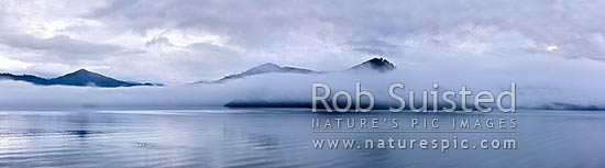 Marlborough Sounds. Misty moody calm grey morning on Queen Charlotte Sound. Panorama, Picton, Marlborough District, Marlborough Region, New Zealand (NZ) stock photo.