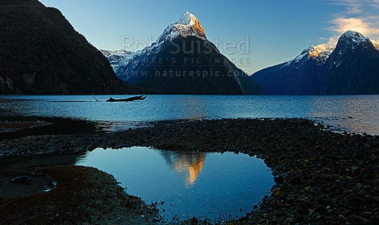 Mitre Peak reflecting in Milford Sound Fiordland. Mitre Peak centre (1683m), The Lion (1302m) far right., Milford Sound, Fiordland National Park, Southland District, Southland Region, New Zealand (NZ) stock photo.