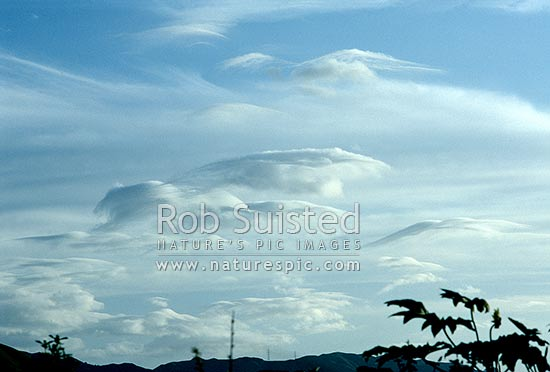 Unusual clouds forming over coastal hills, Levin, New Zealand (NZ) stock photo.
