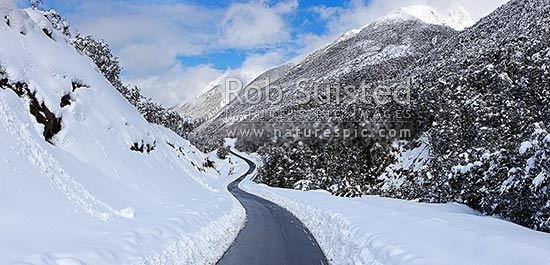 Arthur's Pass road in heavy winter snow. State Highway 73 to West Coast. Looking east. Panorama, Arthur's Pass National Park, Selwyn District, Canterbury Region, New Zealand (NZ) stock photo.