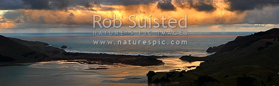 Otago Peninsula, Allans Beach and Hoopers Inlet on a stormy winter evening. Panorama, Otago Peninsula, Dunedin City District, Otago Region, New Zealand (NZ) stock photo.