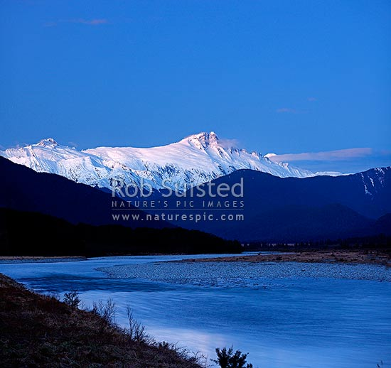 Mount Hooker (2652m centre) Mt Cullaugh (2286m left) above the Haast and Landsborough Rivers at dusk in winter. Square format, Haast, Westland District, West Coast Region, New Zealand (NZ) stock photo.