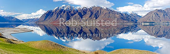 Lake Hawea on a perfect calm spring/winter day reflecting the surrounding snowy ranges. Panorama, Hawea, Queenstown Lakes District, Otago Region, New Zealand (NZ) stock photo.