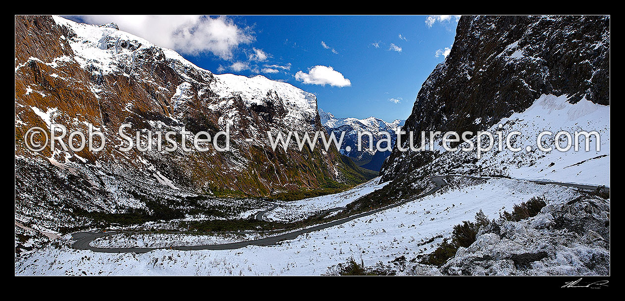 Image of Milford Sound Road, looking down the Cleddau Valley from Homer Tunnel, Darran Mountains. State Highway 94 in winter. Sheerdown Hills in centre distance. Panorama, Milford Sound, Fiordland National Park, Southland District, Southland Region, New Zealand (NZ) stock photo image