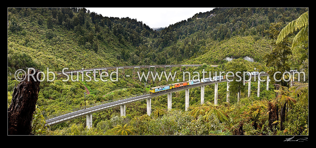 Image of Hapuawhenua Viaducts, historic and modern, with Electric frieght train crossing heading north. North Island Main Trunk Railway Line (NIMT), Ohakune, Ruapehu District, Manawatu-Wanganui Region, New Zealand (NZ) stock photo image
