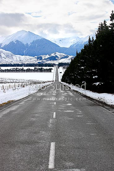 Arthur's Pass State Highway 73 to West Coast in heavy winter snow near Lake Grassmere. West Coast Road. Winter driving, Arthur's Pass National Park, Selwyn District, Canterbury Region, New Zealand (NZ) stock photo.