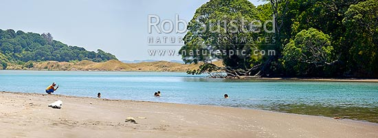 Waiotahi River panorama, with family enjoying summer swimming at river mouth on the Bay of Plenty coastline, Waiotahi River, Ohiwa, Opotiki District, Bay of Plenty Region, New Zealand (NZ) stock photo.