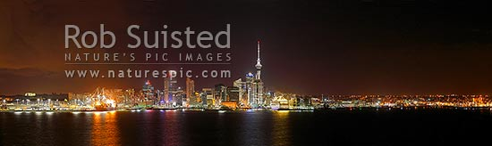 Auckland City night time panorama of CBD, buildings, port, waterfront and Sky tower from Devonport, with cruise ship berthed, Auckland City, Auckland City District, Auckland Region, New Zealand (NZ) stock photo.