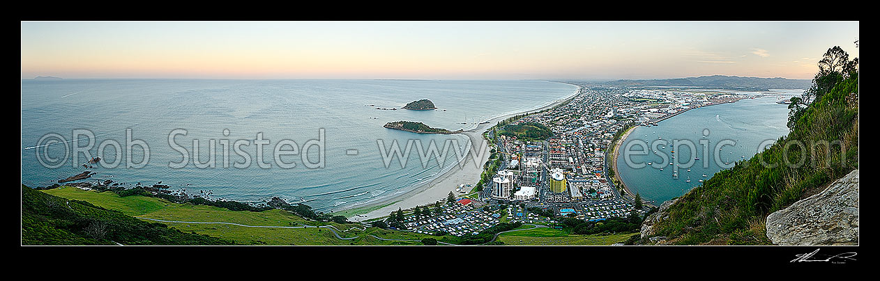 Image of View from Mt Maunganui (232m) over beach and Moturiki and Motuotau Islands, towards Papamoa, Tauranga Harbour right. Panorama at dusk, Mount Maunganui, Tauranga District, Bay of Plenty Region, New Zealand (NZ) stock photo image