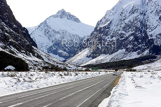 Road to Milford Sound State Highway 94, Cleddau River Valley. Mt Talbot (2105m) behind. Winter snow. Summer version available: 30485TS00, Fiordland National Park, Southland District, Southland Region, New Zealand (NZ) stock photo.