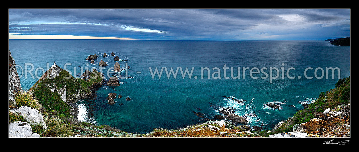 Image of Nuggets Lighthouse at dusk. Nugget point and Tokata Point left and Long Point right, Catlins. South Otago Panorama, Catlins, Clutha District, Otago Region, New Zealand (NZ) stock photo image