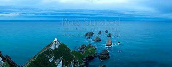 Nuggets Lighthouse at dusk. Nugget point and Tokata Point, South Otago Panorama, Catlins, Clutha District, Otago Region, New Zealand (NZ) stock photo.