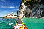 Tourist kayaking at Abel Tasman