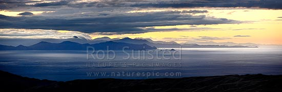 Cook Strait evening panorama. Looking West towards Marlborough Sounds, Mount Stokes in cloud, The Brothers Islands (centre) and Cape Jackson (left), Cook Strait, Wellington City District, Wellington Region, New Zealand (NZ) stock photo.