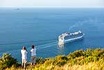 Couple watching cruise ship depart